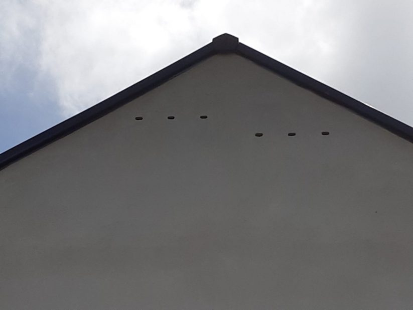 Triple brick nest box shown in its finished state, on a gable end.